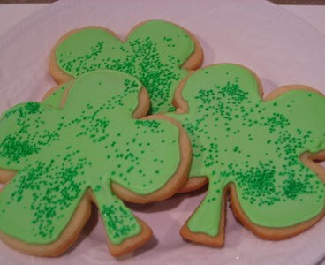 shamrock sugar cookies on white plate