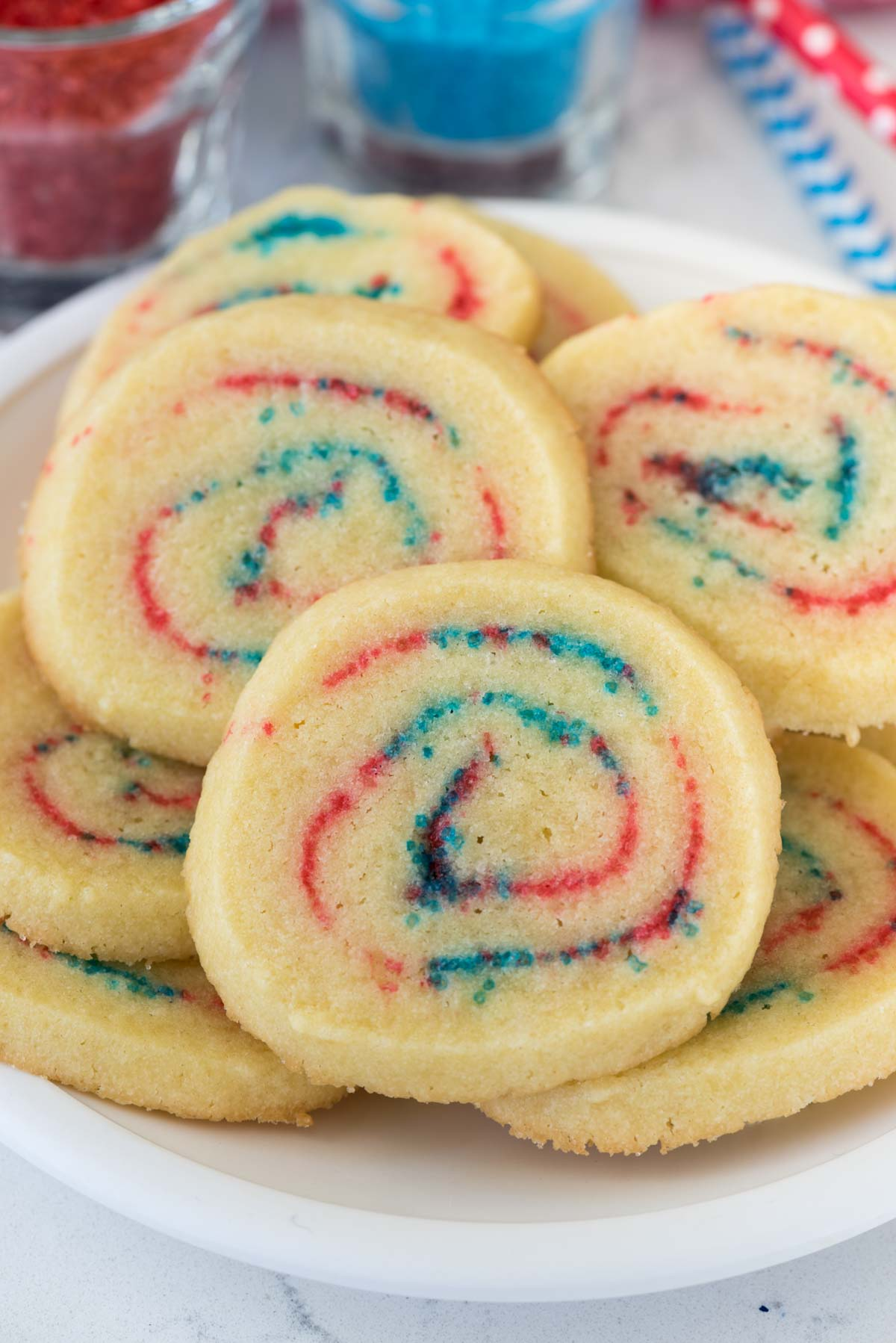 4th of July Spiral Cookies - these easy sugar cookies are rolled with red and blue sugar making them look like a firework! The perfect recipe for Independence Day!