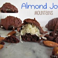 almond joy mountains - chocolate brownie bites with coconut topping and covered in chocolate on a marble slab with words on photo