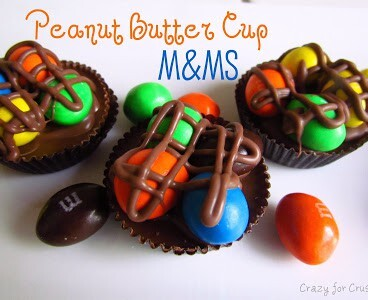 peanut butter cups with MandMs on top and chocolate with words on photo