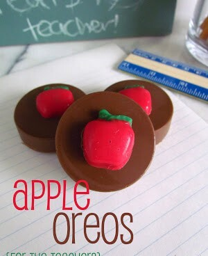 chocolate covered oreos with a chocolate red apple and text on photo
