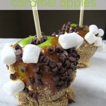 S'more Caramel Apples green apple on a stick with caramel, graham crackers, chocolate chips and marshmallows