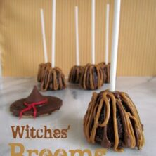 brownie bites with sticks decorated to look like witches brooms