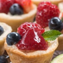 close up of mini fruit tart with berries