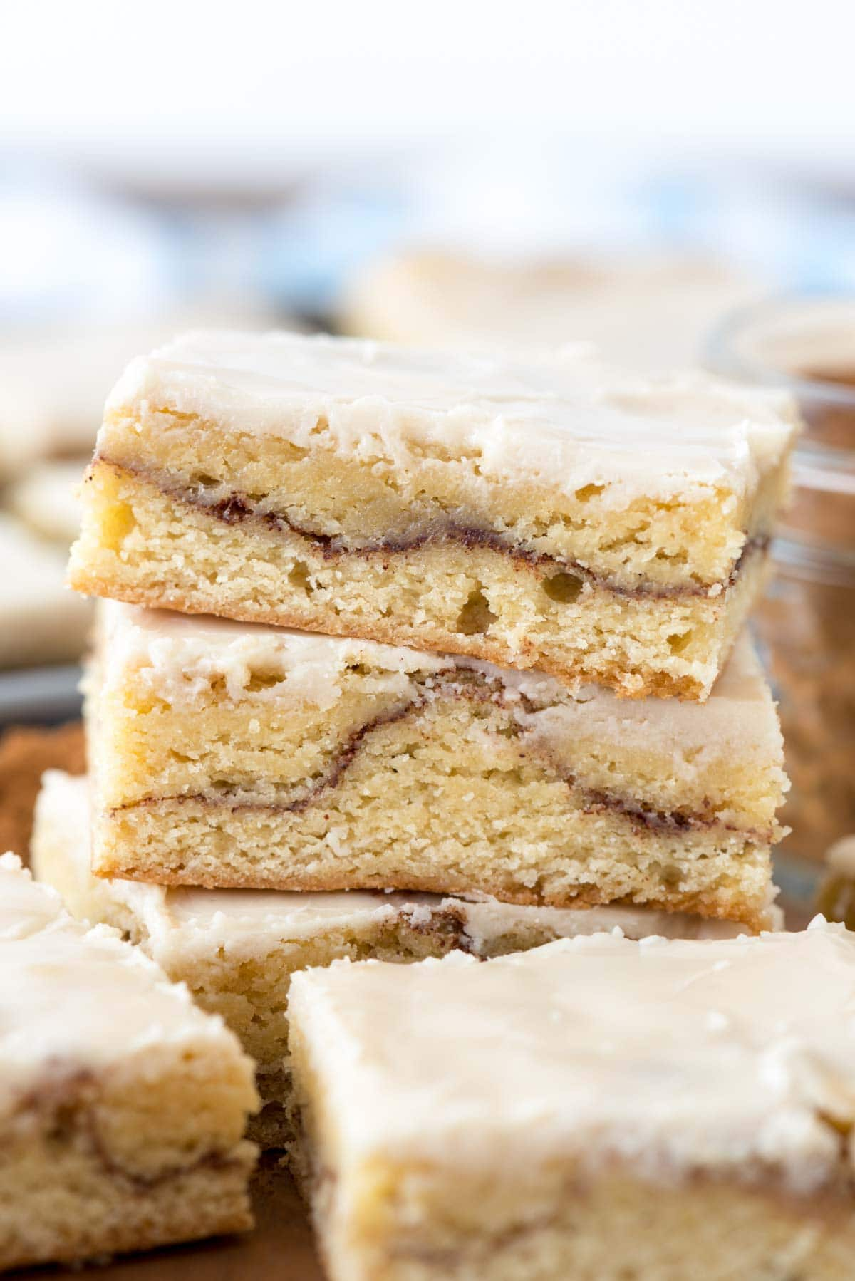 Snickerdoodle Bars - this easy cookie bar recipe is the cross between a gooey cakey blondie and a sugar cookie bar! It's FILLED with cinnamon sugar and topped with icing!