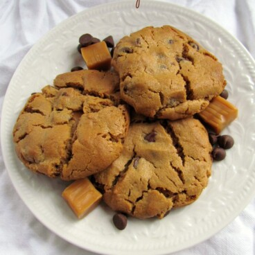 peanut butter caramel chocolate chip cookies on white plate