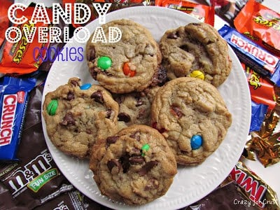 Candy Overload Cookies on a white cookie with candy bars surrounding and title