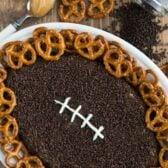 overhead shot of peanut butter football dip with words