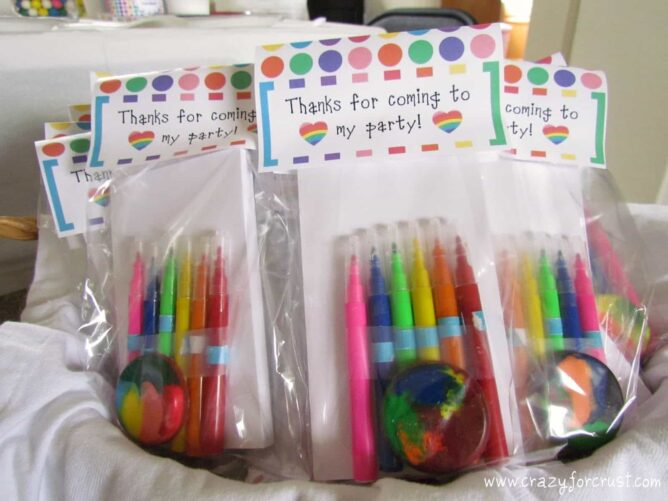 rainbow birthday party favors - crayons and rainbow pens
