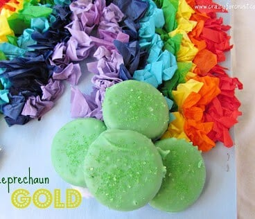 rainbow tissue paper with green chocolate dipped ritz crackers at end