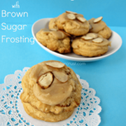 Almond Pudding Cookies with Brown Sugar Frosting on doily and white plate