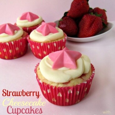 strawberry cheesecake cupcakes in pink liner with polka dots and pink background