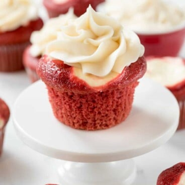 Red Velvet Cream Cheese Cupcakes with text on top