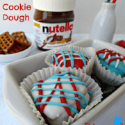 patriotic nutella cookie dough dipped pretzels in a white dish with title