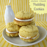Lemon cream pudding cookies on a white plate with a bottle of milk in the background, graphic title on the top right.