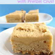 Peanut butter brownies with pretzel crust on a white plate