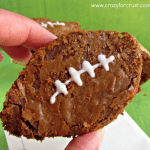 Nutella peanut butter football brownie being held by a woman.