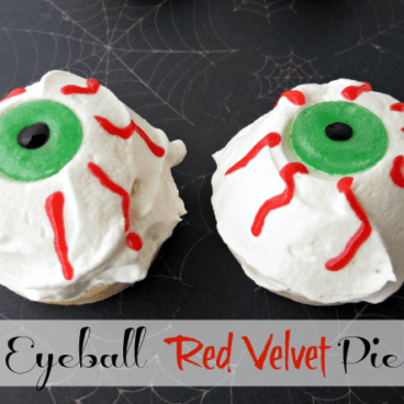 white, red and green eyeball pie laying on a spiderweb background with graphic title on the bottom