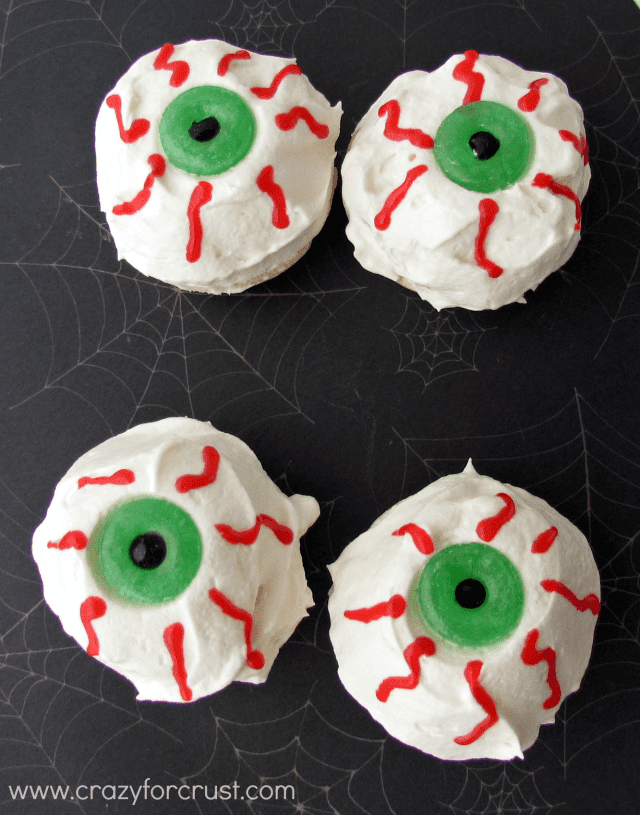 Red Velvet Eyeball Pies with whipped cream and red frosting eyes with lifesaver pupils