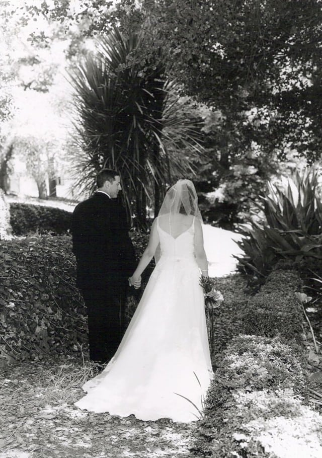 bride and groom walking away from camera