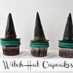 witch hat cupcakes on top of white doilies with white background