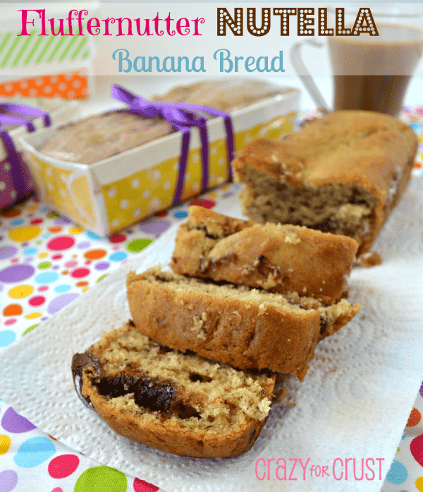 sliced banana bread that's got chocolate inside on colorful linen