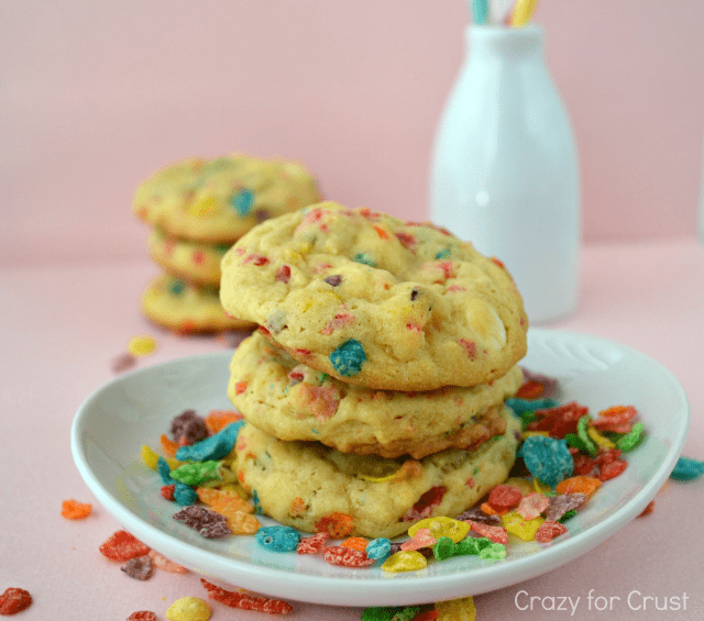 stack of fruity pebbles cookies on a light blue plate