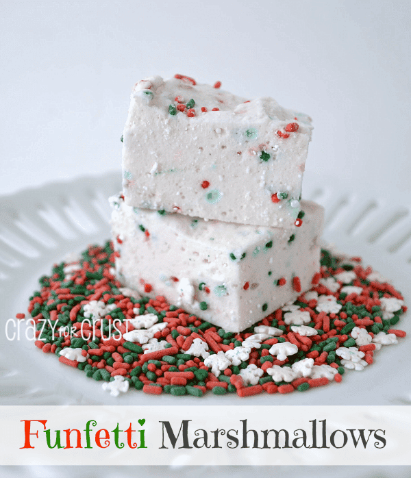 funfetti marshmallows with christmas sprinkles on white platter with words