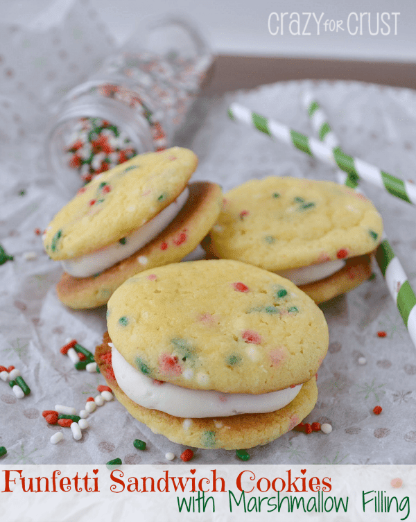 Funfetti Sandwich Cookies with Marshmallow on parchment paper with title