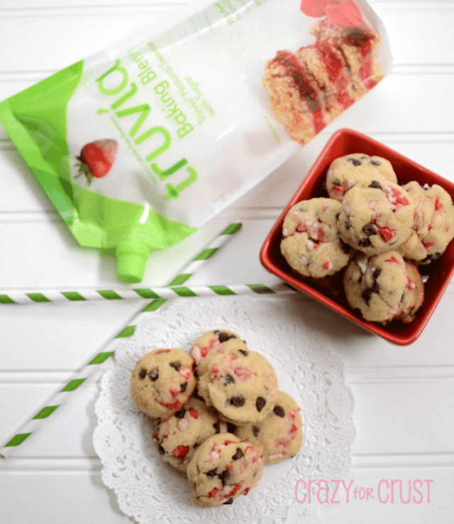 peppermint chocolate chip cookies in a pile with truvia behind on white backgroud