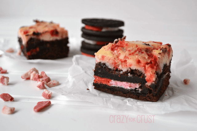 brownies with candy cane oreos and cheesecake on top on white background