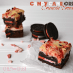 Candy Cane Oreo Cheesecake Brownies with candy cane oreos on a white table, with graphic image at the top right.