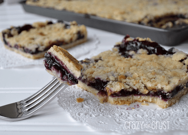 Blueberry slab pie with a bite on a fork