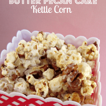 Red and white container of butter pecan cake kettle corn, with graphic title on the top.