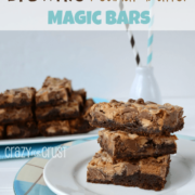 Stack of brownie peanut butter magic bars on a white plate, with more bars and a milk cup with straws in the background, with graphic title on the top.