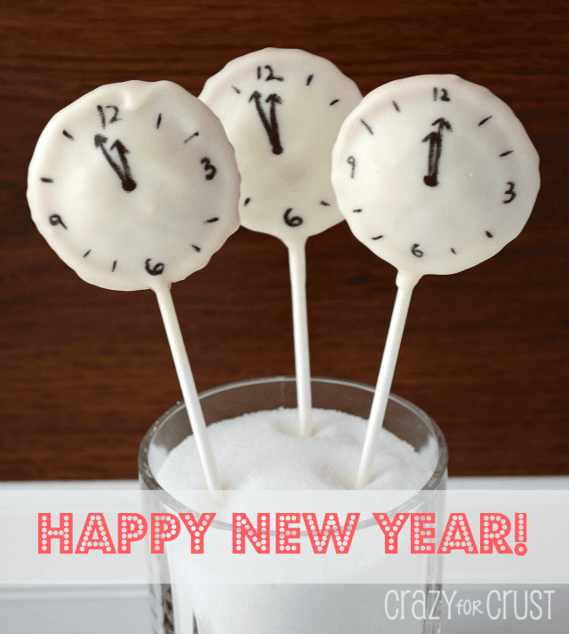 clock pie pops with white chocolate coating and clock face drawn on them