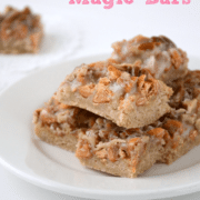 butterscotch pecan magic bars on white plate