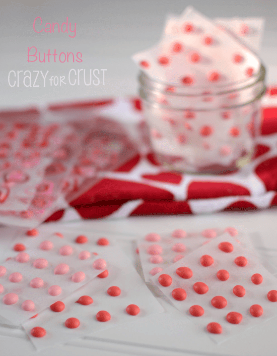 candy buttons on parchment on white surface