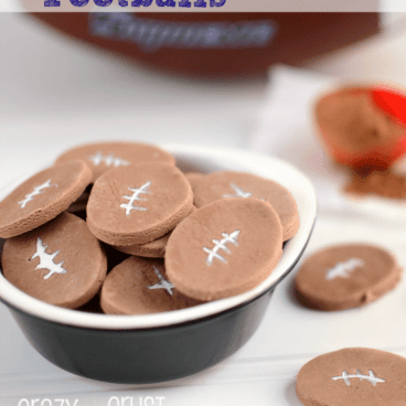 chocolate football conversation hearts on white background and bowl with coco powder and football