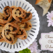 Chocolate Chip Palmiers on white platter with flowers around