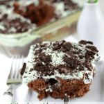 Chocolate Mint Poke Cake on white plate with fork
