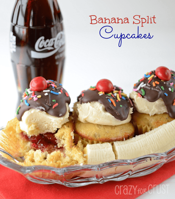 banana split cupcakes in ice cream dish decorated like a sundae with a banana
