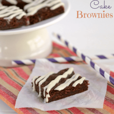 carrot cake brownies on parchment paper and some on cake plate