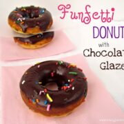 funfetti donuts with chocolate glaze and sprinkles on pink napkin