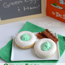 green eggs donuts on white plate