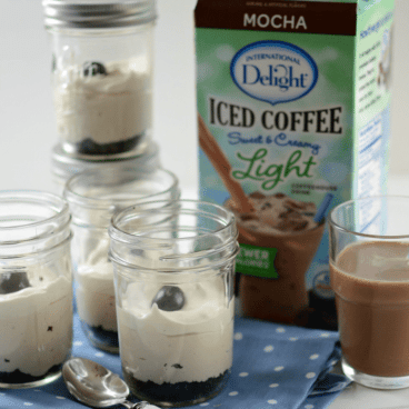 skinny mocha no bake cheesecake in glass jar with crust