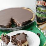 baileys irish creamer cheesecake pie with slice on white plate