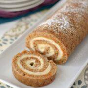 carrot cake roll sliced on white platter