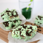 mint chocolate popcorn treats on parchment on cutting board