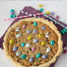 peanut butter cookie pie overhead with easter egg m and ms on purple napkin